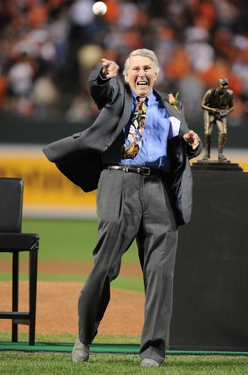 Former Oriole Brooks Robinson throws out the ceremonial first pitch before the game between the Baltimore Orioles and the Boston Red Sox at Oriole Park at Camden Yards on September 29, 2012 in Baltimore, Maryland. (Greg Fiume/Getty Images)
