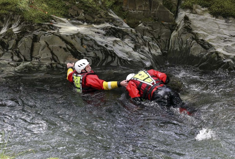 Members of a mountain rescue team search the River Dyfi as the hunt for missing April Jones continues in Machynlleth, Wales. April Jones, a five-year-old girl was abducted from outside her house on Monday night. Police have arrested 46-year-old Mark Bridger in connection with her disappearance in the Machynlleth area. (Matt Cardy/Getty Images)