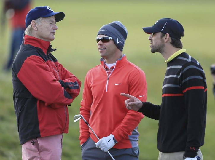 Bill Murray, Paul Casey and Michael Phelps in conversation on the 18th hole during the first round of The Alfred Dunhill Links Championship at Carnoustie Golf Links in Carnoustie, Scotland. (David Cannon/Getty Images)