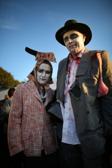 Visitors dressed as a zombie poses at Tulleys Farm in Turners Hill, England on October 6. People dressed as zombies from around the United Kingdom converged on Tulleys Farm in an attempt to set a new Guinness World Record for the most zombies together in one place. (Peter Macdiarmid/Getty Images)