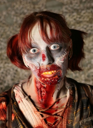 A visitor dressed as a zombie poses at Tulleys Farm in Turners Hill, England on October 6. People dressed as zombies from around the United Kingdom converged on Tulleys Farm in an attempt to set a new Guinness World Record for the most zombies together in one place. (Peter Macdiarmid/Getty Images)