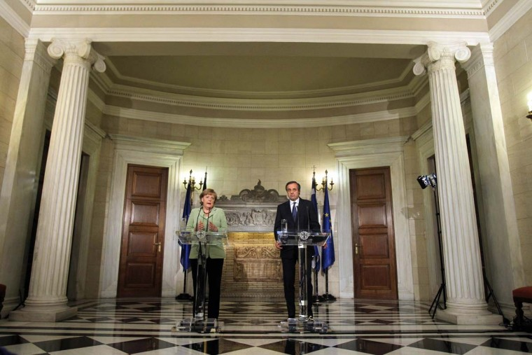 Greek Prime Minister Antonis Samaras (R) and German Chancellor Angela Merkel make statements to the media at the Maximos Mansion October 9, 2012 in Athens, Greece. Merkel's first visit to Greece since the eurozone crisis began three years ago is seen by the government as a historic boost to the country's future in Europe's shared currency, but by protesters as a harbinger of more austerity and hardship. (Thanassis Stavrakis/Getty Images)