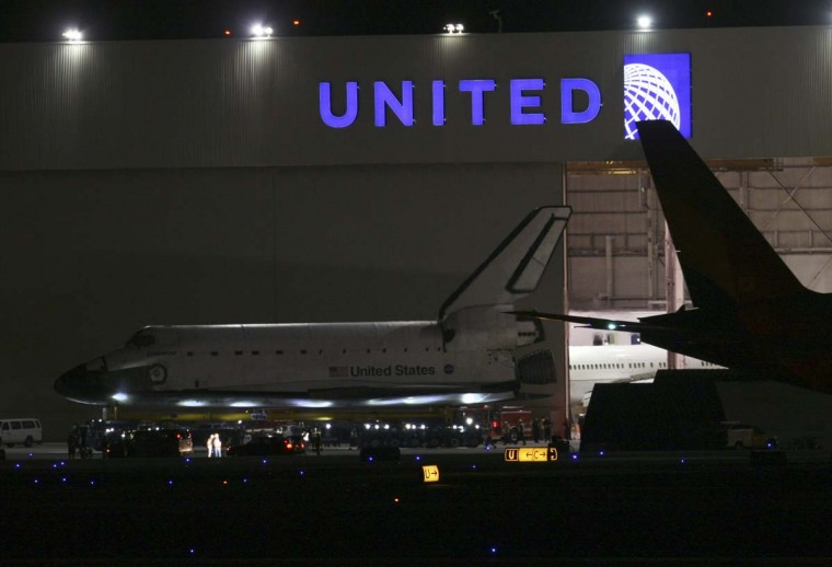 The space shuttle Endeavour is moved out of the United hangar at Los Angeles International Airport just before midnight in Los Angeles, California. The space shuttle will make a two-day trek across Los Angeles and Inglewood to the California Science Center, where it will be on permanent display. (Bryan Chan/Getty Images)