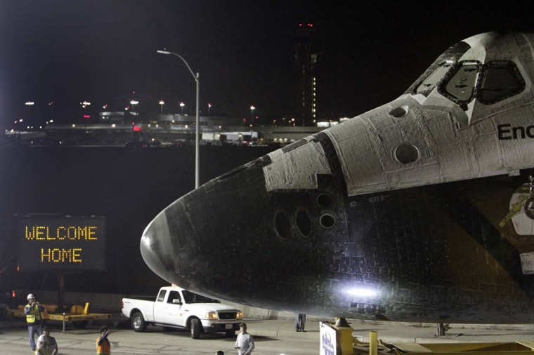 A welcome home sign is displayed on the turn as the space shuttle Endeavour leaves Los Angeles International Airport in the early hours of in Los Angeles, California. (Lawrence K. Ho/Getty Images)