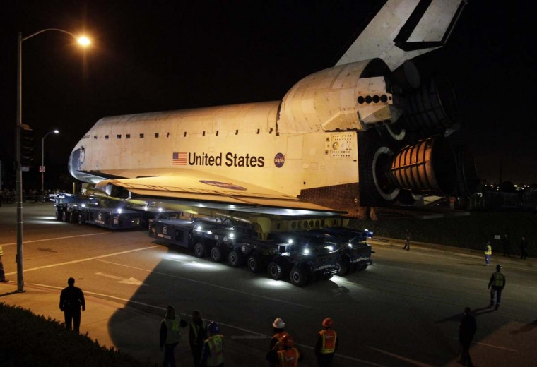 The space shuttle Endeavour leaves Los Angeles International Airport onto the streets of the Westchester neighborhood in the early hours of in Los Angeles, California. The space shuttle will make a two-day trek across Los Angeles and Inglewood to the California Science Center, where it will be on permanent display. (Lawrence K. Ho/Getty Images)