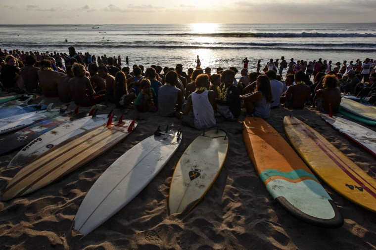 People take part in the Paddle for Peace ceremony at Kuta Beach as part of the Bali Bombing 10th anniversary in Jimbaran, Bali, Indonesia. Thousands of family members, friends and general public gathered to remember the victims of the 2002 Kuta nightclub bombings which killed 202 people, including 88 Australians. (Lee Griffith/Pool/Getty Images)