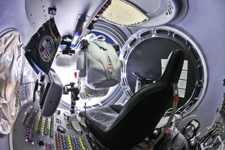 In this handout image supplied by Red Bull Stratos on October 15, 2012, Pilot Felix Baumgartner of Austria prepares to jump out of the capsule during the final manned flight for Red Bull Stratos on October 14, 2012 in space. (Photo by Jay Nemeth/Red Bull Stratos via Getty Images)