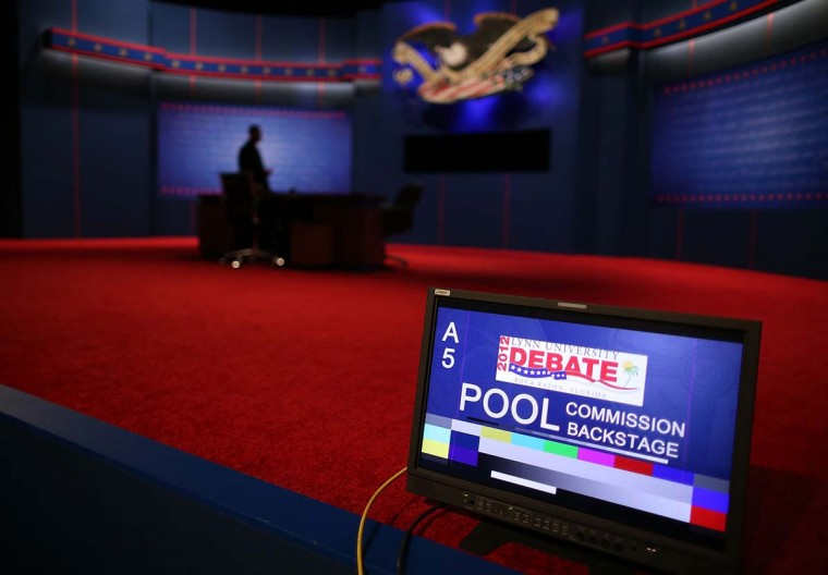 A technician makes final preparations to the debate table where U.S. President Barack Obama and Republican presidential candidate Mitt Romney will face off later tonight at Lynn University October 22, 2012 in Boca Raton, Florida. The U.S. election is a little over two weeks away and recent polls show its becoming a close race. (Mark Wilson/Getty Images)