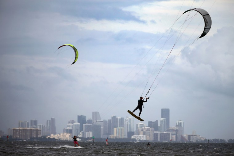 October 24, 2012: Santiago Porteiro (R) and others take advantage of the winds from the outerbands of Hurricane Sandy to kite surf in Miami, Florida. (Joe Raedle/Getty Images)