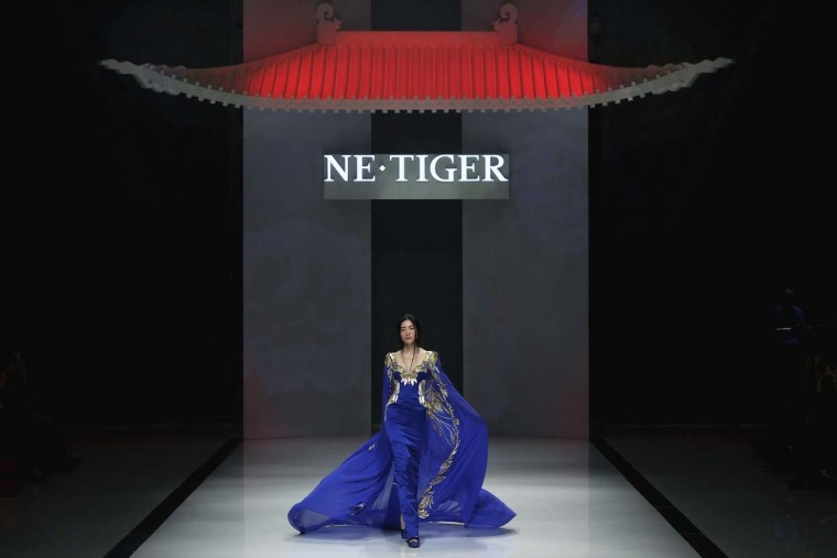 A model showcases designs on the catwalk during the NE(degrees) TIGER Collection of China Fashion Week Spring/Summer 2013 in Beijing, China. (Feng Li/Getty Images)