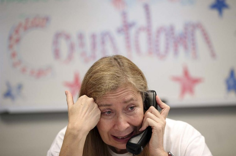 Volunteers make phone calls seeking support for Republican presidential candidate Mitt Romney at his Arlington Victory Center in Arlington, Virginia. Less than two weeks remain before the United States holds its election on November 6. (Win McNamee/Getty Images)