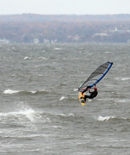 Brewster Jennings of Locust Valley, New York takes advantage of the surf by sailboarding in the Long Island Sound on October 28, 2012 in Bayville, New York. Sandy, which has already claimed over 50 lives in the Caribbean is predicted to bring heavy winds and floodwaters as the Mid-Atlantic region prepares for the damage. (Bruce Bennett/Getty Images)