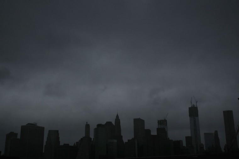 October 29, 2012: Dark clouds are seen over the skyline of Manhattan as as Hurricane Sandy begins to affect the area in New York City. The storm, which threatens 50 million people in the eastern third of the U.S., is expected to bring days of rain, high winds and possibly heavy snow. (Photo by Spencer Platt/Getty Images)