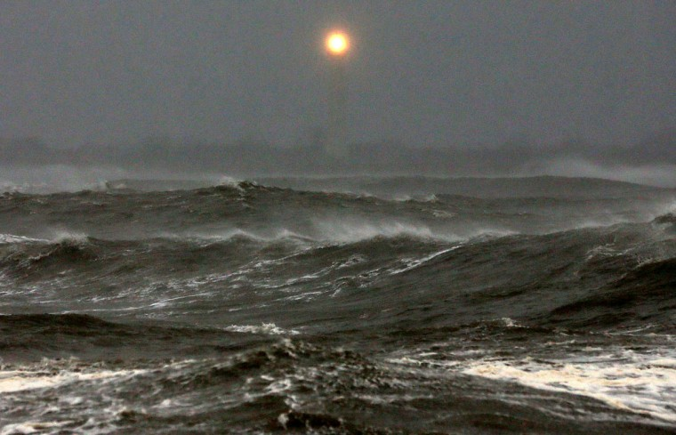 October 29, 2012: The Cape May Lighthouse can be seen as heavy surf from Hurricane Sandy pounds the shoreline in Cape May, New Jersey. Later today the full force of Hurricane Sandy is expected to hit the New Jersey coastline bringing heavy winds and floodwaters. (Mark Wilson/Getty Images)