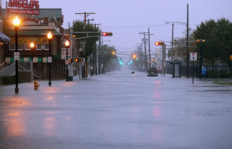 October 29, 2012: Water floods a street ahead of Hurricane Sandy in Atlantic City, New Jersey. Governor Chris Christie'€™s emergency declaration is shutting down the city'€™s casinos and 30,000 residents were ordered to evacuate. (Mario Tama/Getty Images)