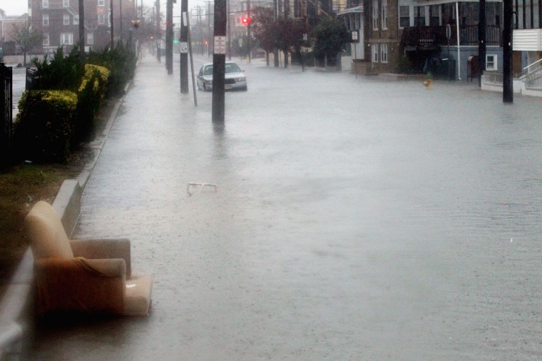 October 29, 2012: Flood waters inundate a street near the ocean ahead of Hurricane Sandy in Atlantic City, New Jersey. (Mario Tama/Getty Images)