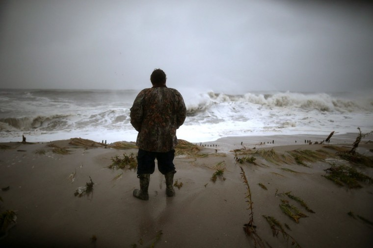 October 29, 2012: Andy Becica stands on the beach in Cape May, New Jersey watching the heavy surf from Hurricane Sandy wash in. (Mark Wilson/Getty Images)
