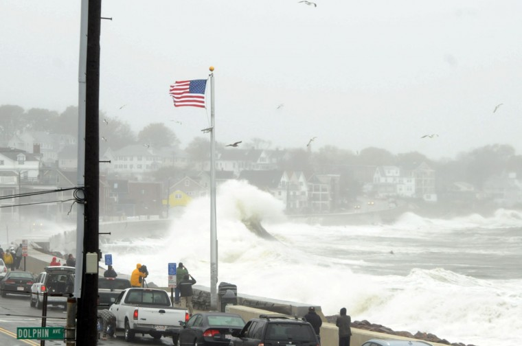 October 29, 2012: Waves crash over Winthrop Shore Drive as Hurricane Sandy comes up the coast in Winthrop, Massachusetts. (Darren McCollester/Getty Images)