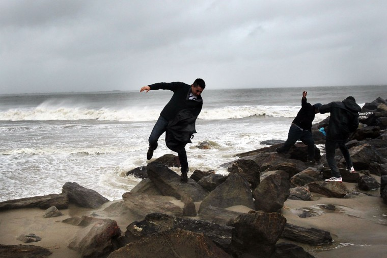 October 29, 2012: A man fights against the wind along Brighton Beach as Hurricane Sandy begins to affect the area in the in Brooklyn borough of New York City. (Spencer Platt/Getty Images)