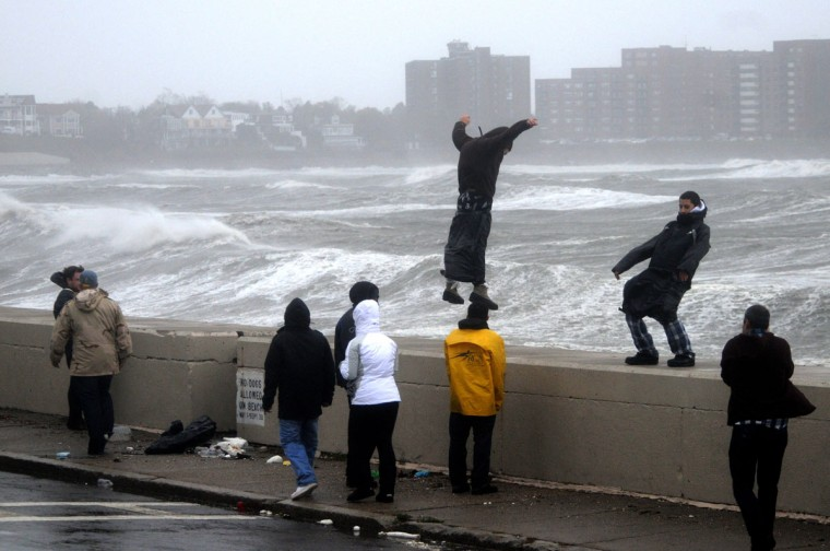October 29, 2012: People brave high winds and waves along Winthrop Shore Drive as Hurricane Sandy comes up the coast in Winthrop, Massachusetts. (Darren McCollester/Getty Images)
