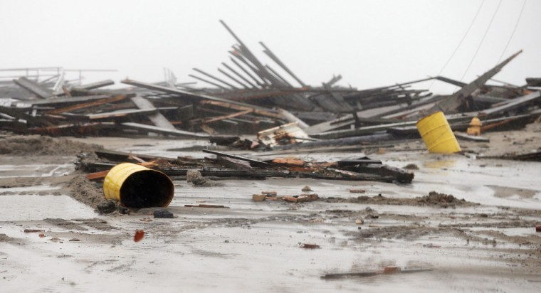 October 29, 2012: Debris from flooding is scattered on a street near the ocean as Hurricane Sandy moves up the coast in Atlantic City, New Jersey. (Mario Tama/Getty Images)