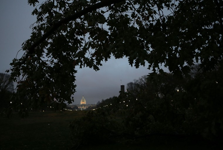 October 30, 2012: With the U.S. Capitol shown in the background, a fallen tree lies along the side of 14th St NW following Hurricane Sandy's track through the nation's capital in Washington. (Win McNamee/Getty Images)