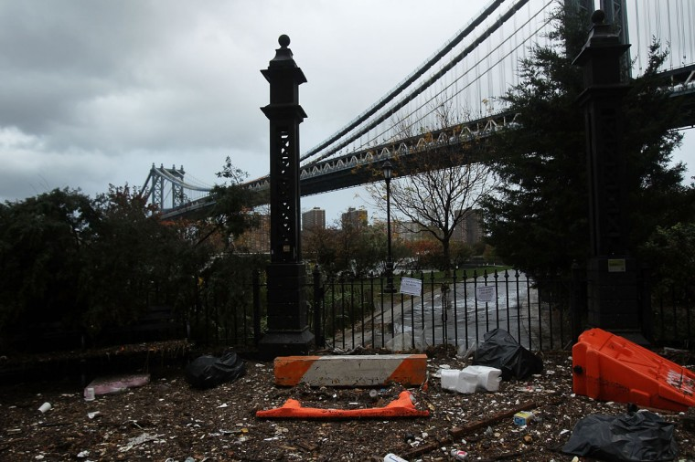 October 30, 2012: Debris litters a flooded street in the Dumbo section of Brooklyn after the city awakens to the affects of Hurricane Sandy in New York. (Spencer Platt/Getty Images)