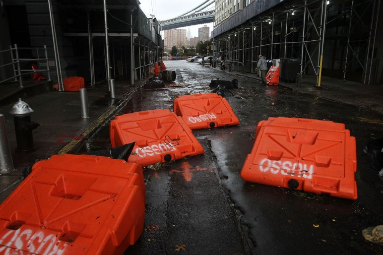 October 30, 2012: Portable upended flood dikes are viewed on a flooded street in the Dumbo section of Brooklyn after the city awakens to the affects of Hurricane Sandy in New York. (Spencer Platt/Getty Images)