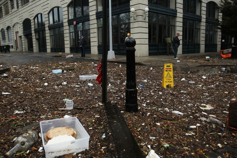 October 30, 2012: Debris litter a flooded street in the Dumbo section of Brooklyn after the city awakens to the affects of Hurricane Sandy in New York. (Spencer Platt/Getty Images)