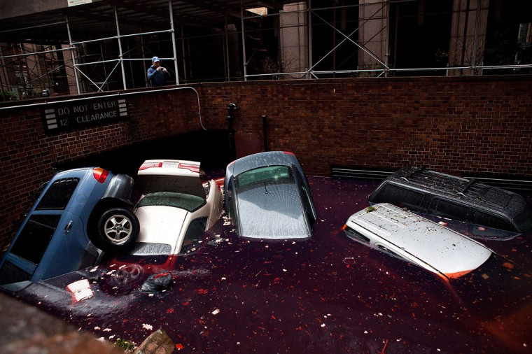 October 30, 2012: Cars floating in a flooded subterranean basement following Hurricaine Sandy in the Financial District of New York. (Andrew Burton/Getty Images)