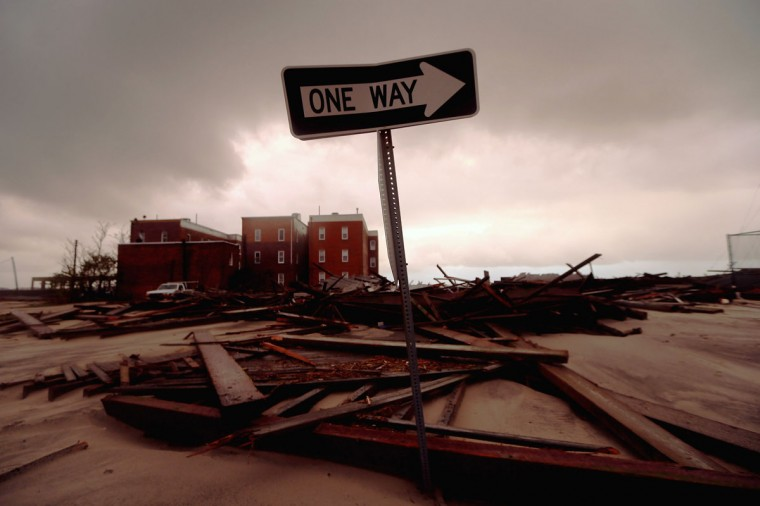 October 30, 2012: A street sign stands near apartment buildings which flooded and destroyed large sections of an old boardwalk in Atlantic City, New Jersey. (Mario Tama/Getty Images)