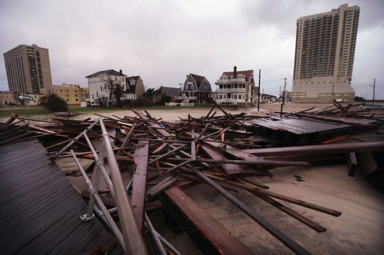 October 30, 2012: Destroyed sections of an an old boardwalk are seen in an area that flooded by the beach in Atlantic City, New Jersey. (Mario Tama/Getty Images)