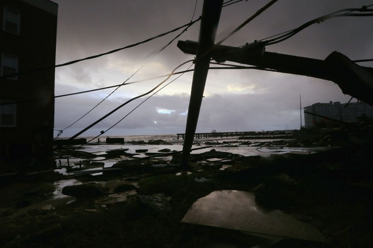 October 30, 2012: Debris and sections of a destroyed old boardwalk are seen in an area that flooded in Atlantic City, New Jersey. (Mario Tama/Getty Images)