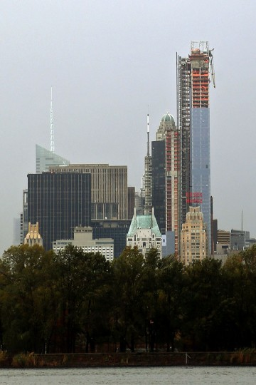 October 30, 2012: A construction crane hangs off of the side of One57, seen from Central Park in New York City. The crane was blown loose from the residential construction project during Hurricane Sandy. (Michael Heiman/Getty Images)