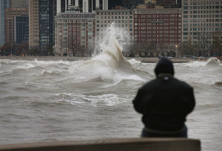 October 30, 2012: A man watches waves generated from the remnants Hurricane Sandy as they crash into the shoreline of Lake Michigan in Chicago, Illinois. Waves up to 25 feet high generated by winds up to 50 miles-per-hour were expected on the lake. (Scott Olson/Getty Images)