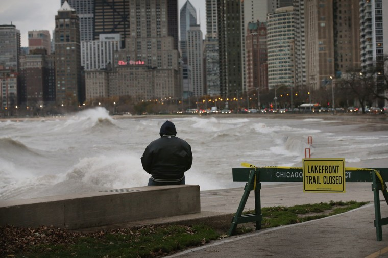 October 30, 2012: A man watches waves generated from the remnants Hurricane Sandy as they crash into the shoreline of Lake Michigan on October 30, 2012 in Chicago, Illinois. Waves up to 25 feet high generated by winds up to 50 miles-per-hour were expected on the lake. (Scott Olson/Getty Images)