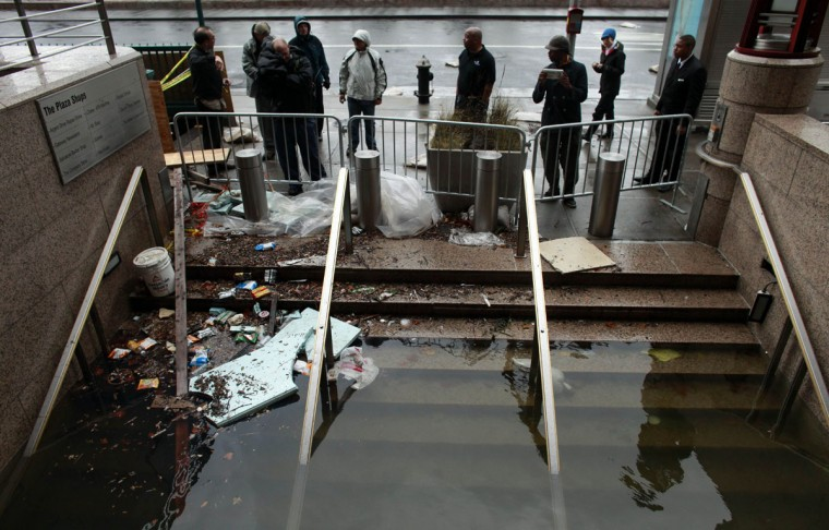 October 30, 2012: Water floods the Plaza Shops in lower Manhattan, New York. (Allison Joyce/Getty Images)
