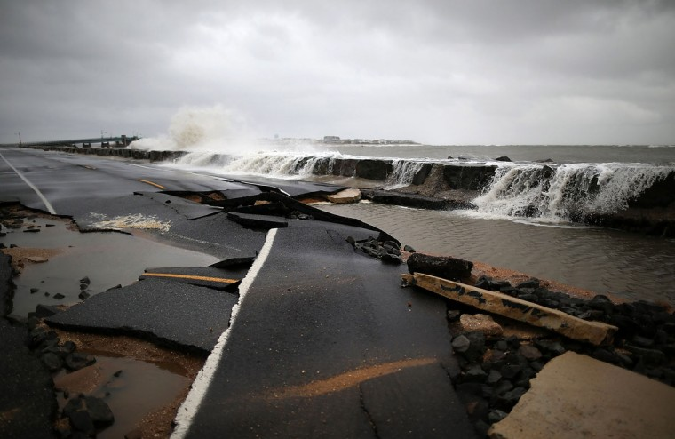 October 30, 2012: Heavy surf caused by Hurricane Sandy buckles Ocean Ave in Avalon, New Jersey. (Mark Wilson/Getty Images) ORG XMIT: 155275543
