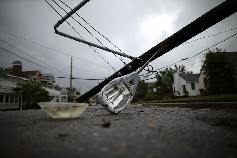 October 30, 2012: A street light and utility pole brought down from Hurricane Sandy lays on the street in Avalon, New Jersey. (Mark Wilson/Getty Images)