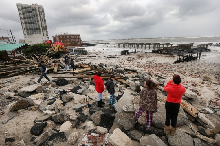 October 30, 2012: People view the area where a 2000-foot section of the 'uptown' boardwalk was destroyed by flooding from Hurricane Sandy in Atlantic City, New Jersey. (Mario Tama/Getty Images)