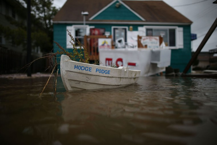 October 30, 2012: A flower pot boat floats in front of a bait and takle store on flooded Ocean Ave. in Avalon, New Jersey. (Mark Wilson/Getty Images)