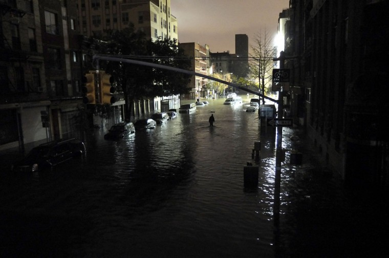 October 30, 2012: A general view of submerged cars on Ave. C and 7th st, after severe flooding caused by Hurricane Sandy in Manhattan, New York. (Christos Pathiakis/Getty Images)