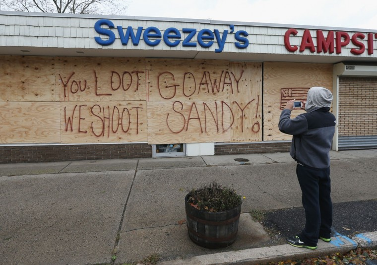 October 30, 2012: A sporting goods and camping store displays it's message to residents in the aftermath of Hurricane Sandy in Huntington Station, New York. (Bruce Bennett/Getty Images)