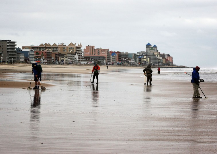 October 30, 2012: People participate in metal detecting at the beach after Hurricane Sandy hit the region in Ocean City, Maryland. (Alex Wong/Getty Images)