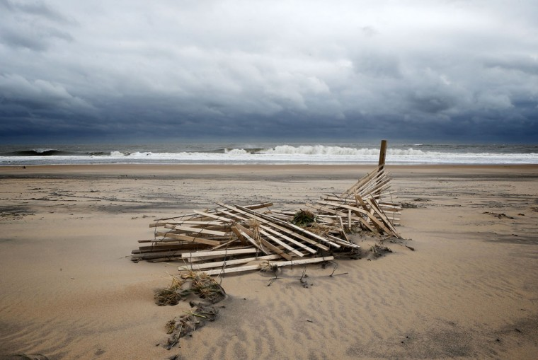 October 30, 2012: A damaged wooden fence lies at the beach after Hurricane Sandy hit the region in Ocean City, Maryland. (Alex Wong/Getty Images)