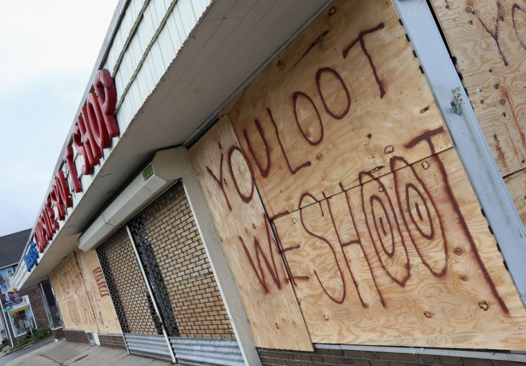 A sporting goods and camping store displays its message to residents in the aftermath of Hurricane Sandy in Huntington Station, New York. (Bruce Bennett/Getty Images)