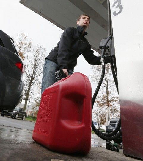 Alex Sbrocchi of Melville, N.Y., fills up with gas in the aftermath of Hurricane Sandy on October 30, 2012 in Farmingdale, N.Y. The storm has claimed at least a few dozen lives in the U.S., and caused massive flooding across much of the Atlantic seaboard. (Bruce Bennett/Getty Images)