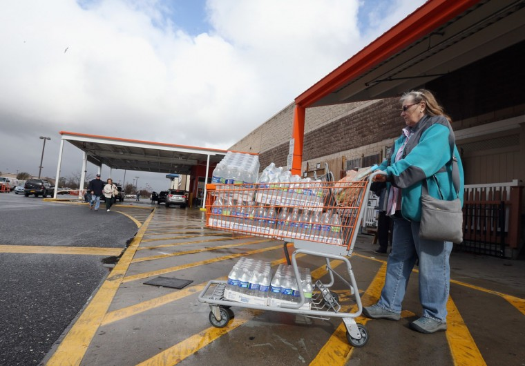 Sharon Karr leaves Home Depot with water for FEMA workers in the aftermath of Hurricane Sandy on October 30, 2012 in Plainview, N.Y. (Bruce Bennett/Getty Images)