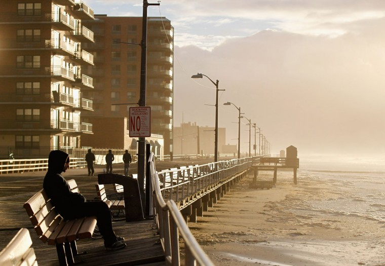 The heavy surf breaks against the boardwalk on October 30, 2012 in Long Beach, New York. The storm has claimed at least 40 lives in the United States, and has caused massive flooding across much of the Atlantic seaboard. US President Barack Obama has declared the situation a 'major disaster' for large areas of the US East Coast including New York City. (Mike Stobe/Getty Images)