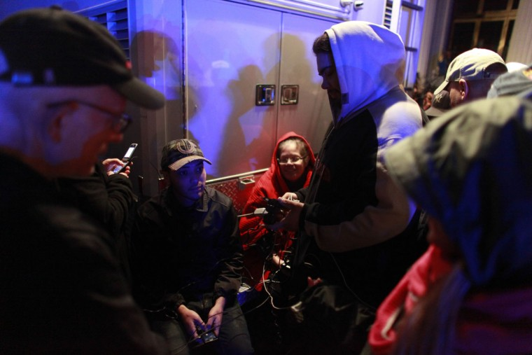 People charge their phones at a mobile charging station in the aftermath of Hurricane Sandy in New York City. The storm caused massive flooding across much of the Atlantic seaboard, leaving millions of people without power. (Allison Joyce/Getty Images)